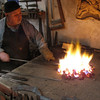 Yuri Borodin, blacksmith & artisan, stoking the flames. (Vladimir, Russia)