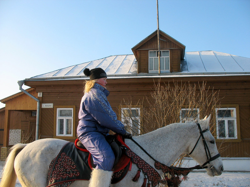 Girl riding on the streets of Suzdal - Check out those boots!