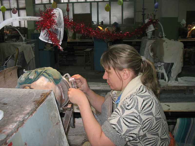 Cutting glass at The Crystal Goose Factory.