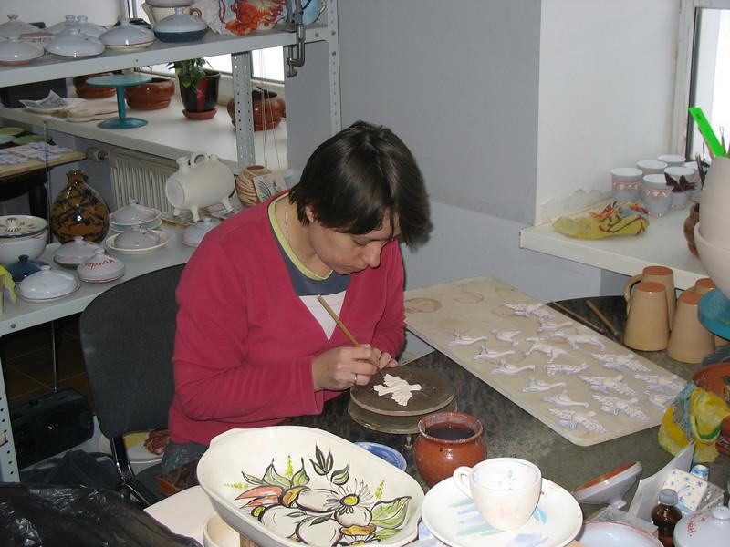 Painting glazed ceramics at Dimov Ceramics.