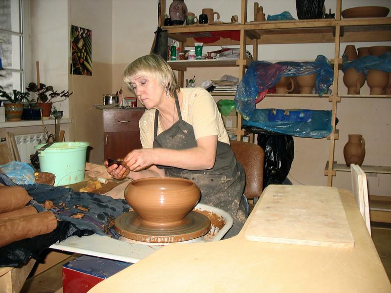 Potter at work. Dimov Ceramics Workshop.