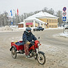 A three-wheeled motorcycle on the snowy streets of Uglich.