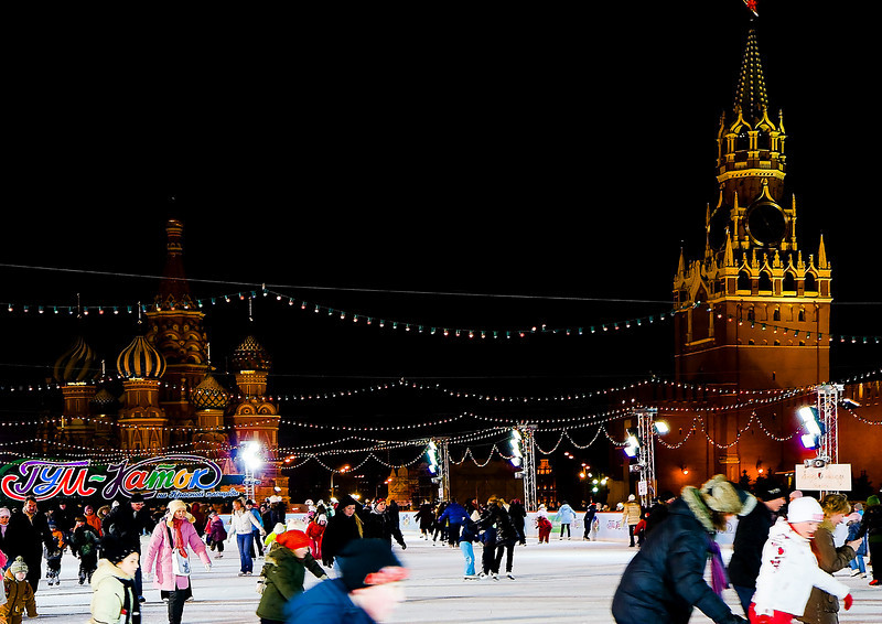 Skating Rink On The Red Square, Moscow, Russia.<br /> <br /> Behind the skating rink you can see The Cathedral of Intercession of the Virgin on the Moat (St. Basil the Blessed) and The Spasskaya Tower (Savior Tower). The tower is the main tower with a through-passage on the eastern wall of the Moscow Kremlin, which overlooks the Red Square.<br /> <br /> The tower was built in 1491 by an Italian architect Pietro Antonio Solari. Initially, it was named the Frolovskaya Tower after the Church of Frol and Lavr in the Kremlin (it is no longer there). The tower's modern name comes from the icon of Spas Nerukotvorny (Divine Savior), which was placed above the gates in 1658 (also no longer there). The Spasskaya Tower was the first one to be crowned with the hipped roof in 1624-1625 by architects Bazhen Ogurtsov and Christopher Galloway (a Scottish architect and clockmaker). According to a number of historical accounts, the clock on the Spasskaya Tower appeared between 1491 and 1585. It is usually referred to as the Kremlin clock.
