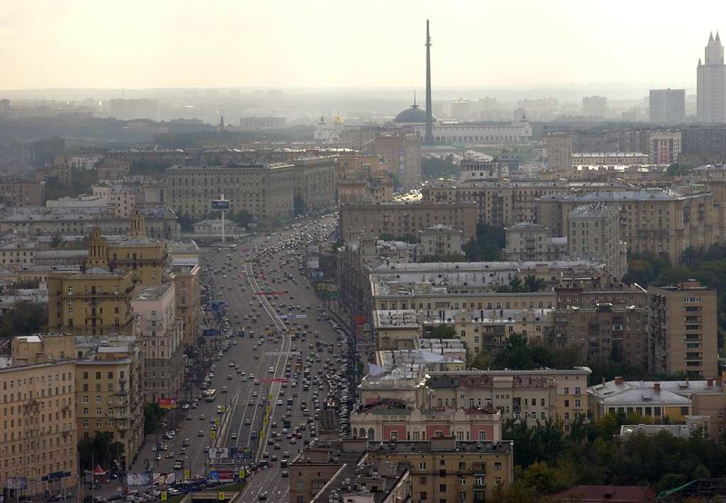 Moscow panorama from the Ukraina (now Radisson Royal) Hotel, 24 September 2004 12.  Looking south west along Kutozvsky Prospekt.  The prominent obelisk is at Victory Park and commemorates Russia's victory over Germany in the Great Patriotic War (1941 - 1945).   It is 141.8m / 465 feet high - 10cm for each day of the war.