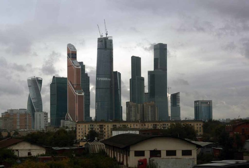 International business centre, west central Moscow, 29 August 2015.  The supertall skyscraper with two cranes on top is Federation Tower East, Europe's tallest building at 374m / 1227 feet.  Photographed from inside a bus.