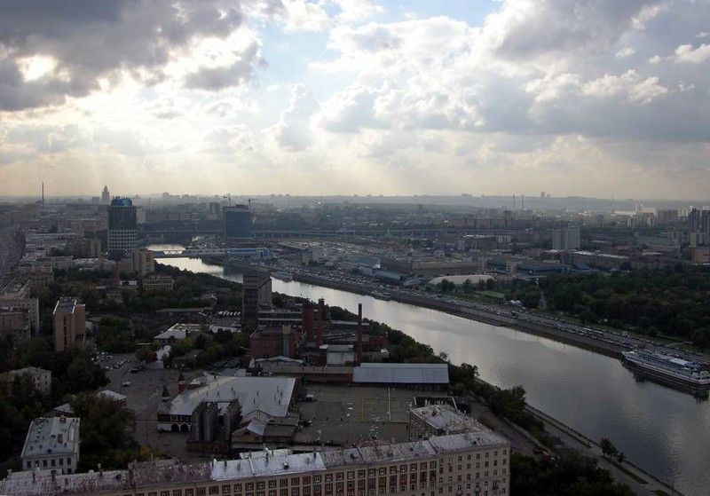Moscow panorama from the Ukraina (now Radisson Royal) Hotel, 24 September 2004 14.  Looking west along the Moscow River.  This scene will now be dominated by the new international business centre, seen in the next photo.