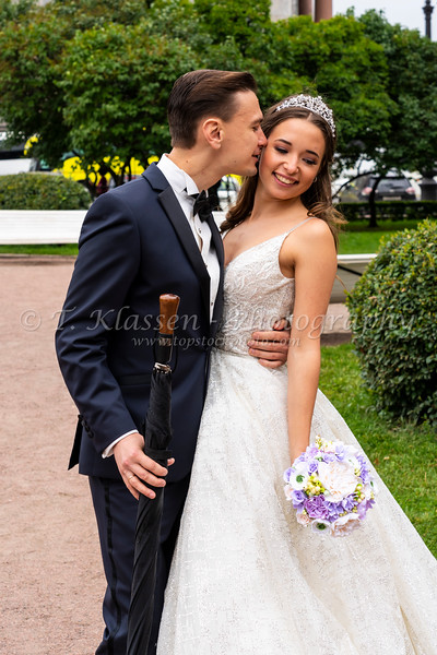 A wedding couple pose for pictures in St. Petersburg, Russia.