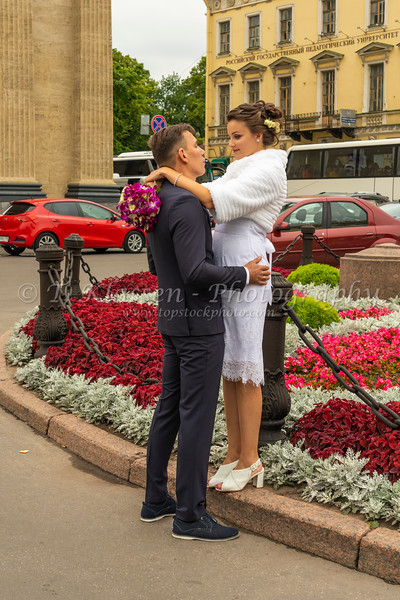 A Russian wedding couple pose for pictures near the Kazan Cathedral in Saint Petersburg, russia.