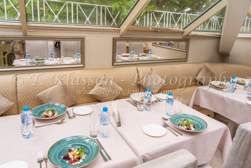 Table setting and the Park Giuseppe restaurant interior in St. Petersburg, Russia.