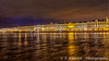The State Hermitage Museum illuminated at night reflected in the Neva River in St. Petersburg, Russia.