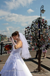 Metal trees of Love Padlocks or Love Locks, Luzhkov Bridge, Vodootvodny Canal, Moscow. A modern Russian Wedding Tradition