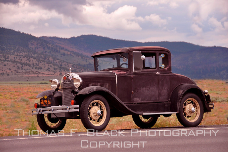 This and seven frames following, 1931 Ford coupe out touring on a summer afternoon, Hwy. A23, Sierra County, CA. Owner said he has owned it since buying it in public auction for $303. He elected not to restore it, although some mechanical changes were made. [UFP062510]