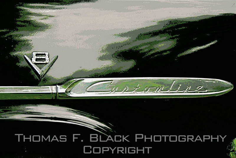 Model-designation chrome strip over right front fender. Note that car is V8. [UFP 072609]