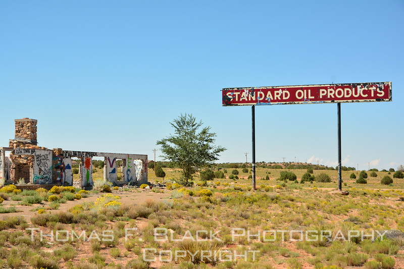 abandoned standard oil (Now chevron) station and trading post on navajo reservation. while I was taking pictures, a najavo drove up in a beat-up truck. I looked for a gun rack and found none. he got out, introduced himself and proceeded to relate the sad backstory. said he worked there as a teen. when epa rules took effect in 1970s, standard oil was ordered to clean up the soil toxins. Instead, it effectly thumbed its nose at the edict and left the building behind. tanks remain in ground.