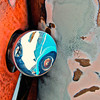 This frame and next, gasoline filler neck and cap. Reflection is of old VW Beetle parked alongside. [UFP031311]