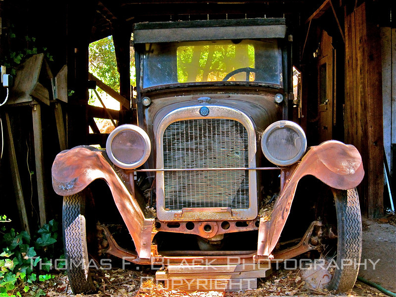 This and six frames following, 1924 Dodge flatbed parked in barn at Boeger winery, Placerville, CA. [UFP072410]