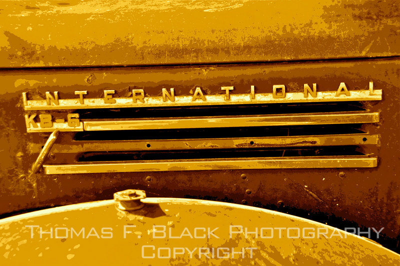 Fender louvers bedecked by name badge, rendered in sepia tone with special graphic effect applied. [UFP052910]
