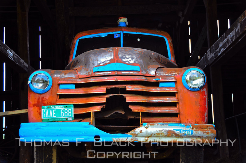 This and four frames following, early 1950s Chevrolet pickup parked inside barn in Vermont. Blue tape on chrome suggests owner plans DIY paint job. [UFP053010]