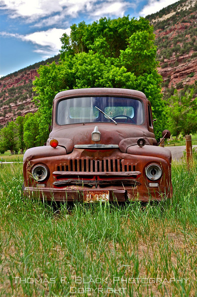 This and four frames following, forsaken 1940s International Harvester pickup alongside road north of Durango, CO. [UFP070110]