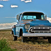 IMAGES IN THIS GALLERY ARE ARRANGED IN ALPHABETICAL ORDER BY MARQUE. This and two frames following, 3600 series 1957 Chevrolet discovered alongside Hwy. 25, north of Taos, NM. [UFP063010]