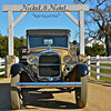This and three frames following, beautifully restored 1930 Ford truck used as marquee at entrance to Nickel & Nickel Winery, Hwy. 29, Oakville, in Napa Valley, CA. [UFP011212]