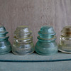 Old telephone pole glass insulators, no longer used, Mississippi. They are now collector items. [UFP050811]