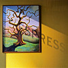 Shadow of sign in storefront window cast across oil painting inside caffe, Walnut Creek, CA. [UFP111110]