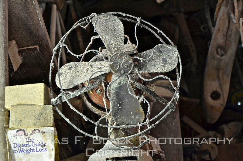 Slightly dusty GE electric fan found inside nation's oldest water grist mill still in operation, central Mississippi. Opened in 1790, mill is operated by descendants of founder. [UFP050611]