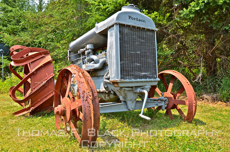"This and two frames following, Fordson tractor in permanent ""park"" in yard outside Seal Cove Auto Museum, Seal Cove, ME. [UFP072011]"