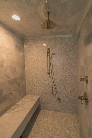 This master shower is large enough to have a party !