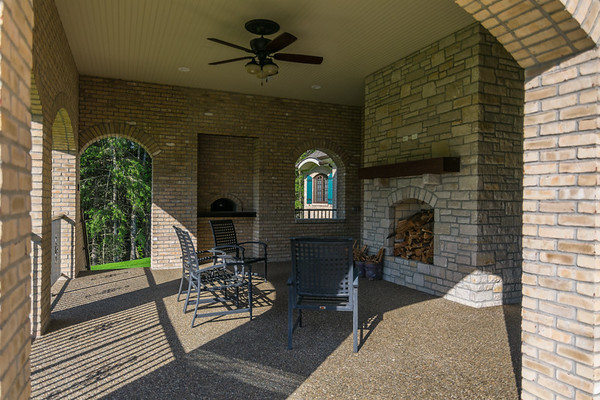 Couldn't you see yourself lounging in front of the outdoor fireplace ?