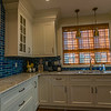 Details, details, details.....notice the task lighting above the sink and deep crown molding.