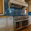 Multiple burner range, custom tile and proper venting.