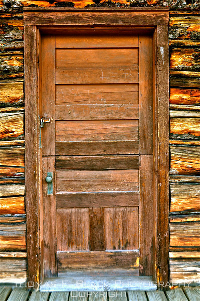 Dutch (split) door to genuine old log cabin, Vermont. [UFP102810]