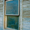 "Crayon message inscribed on pane reads ""A cutie lives here."" Plumas County, CA. [UFP 070509]"