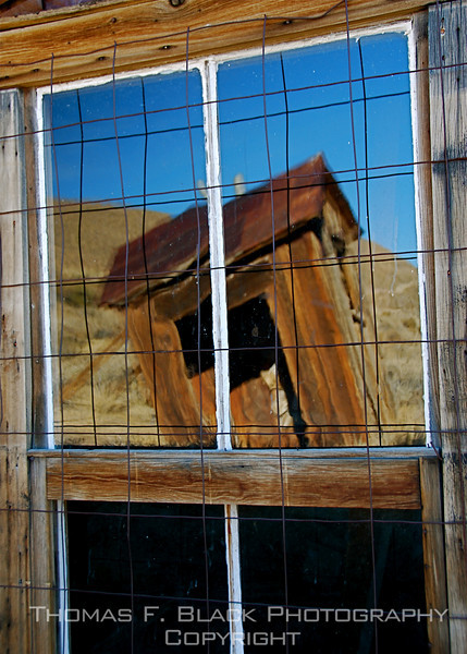 Abandoned privvy reflected in window, Bodie, CA. [UFP 101109]