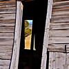 Looking through window of vacant barn. In background is countryside in glow of afternoon autumn sun, central OR. [UFP102010]