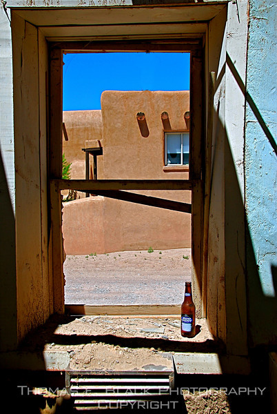 Note bottle of Bud Light on sill. New Mexico. [UFP 051209]