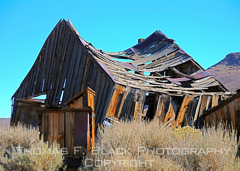 "Ramshackle barn in ""ghost town"" of Bodie, CA. Old gold-mining town once boasted population of 10,000. Last of denizens turned out the lights for keeps in 1938. Today Bodie is centerpiece of California State Historic Park. [UFP 101109]"