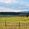 This and frame following, barn in San Juan Mountains, south of Durango, CO, basking in glow of setting sun against backdrop of azure sky. [UFP062910]