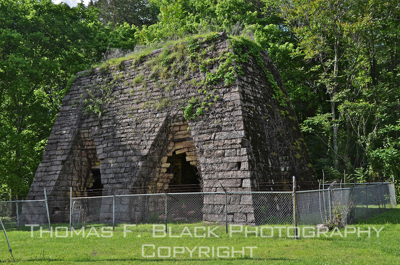 """Although surrounded by """"secure"""" chain-link fence, gate was open, allowing subsequent shots in this series, including those taken from base of one of two cylindrical chimneys, both constructed of stone. [UFP050311]"""