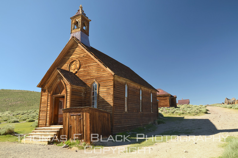 This and 25 frames following, scenes from Bodie, CA, so-called ghost town. Once a flourishing gold-mine community with a peak population of 10,000 in the late 1800s, the last resident turned out the lights decades ago. It is now preserved and open to the public as Bodie State Historic Park, located in Mono County, CA, on the eastern side of the Sierra Nevada mountain range. [10/09 & 07/11]