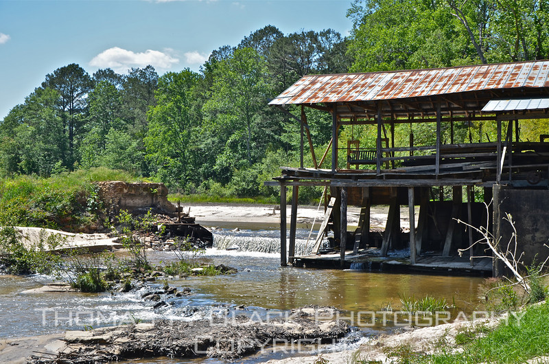 """This and four frames following, Sciple's Water Mill, near Lynville, MS. Opened in 1790, it is said to be oldest water grist mill still in operation in America, run by descendants of the founder. It was featured in 2010 on """"Dirty Jobs"""" on the Discovery Channel. Until shortly before these photos were taken, when it suddenly collapsed, a wooden bridge connected shed and rock foundation to left of waterfall. Owner said bridge would be rebuilt and that mill will remain in operation. [UFP050611]"""