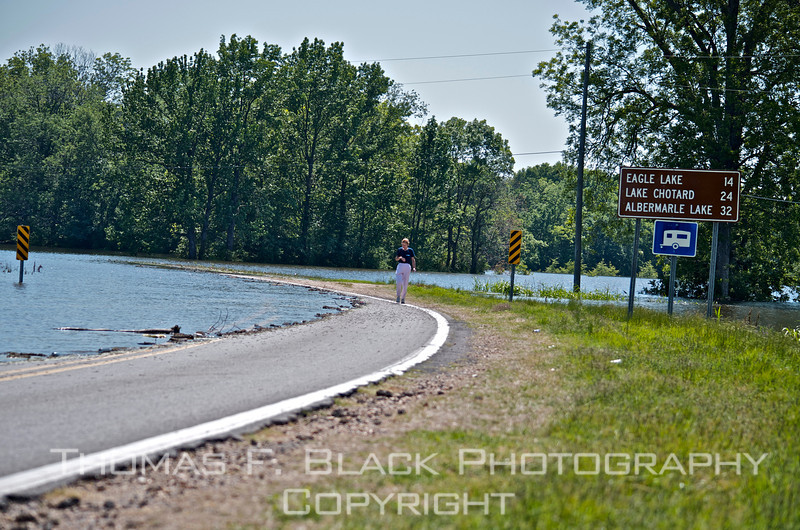 This and three frames following, Yazoo River flooding forces closure of Hwy. 465 across Mississippi River north of Vicksburg, May 2011.