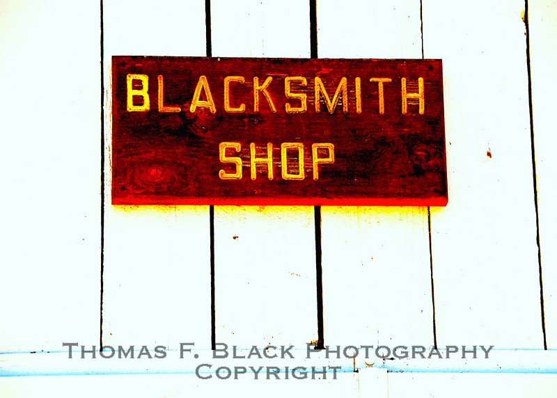 Sign on working blacksmith shop on working horse ranch, Solano County, CA. [UFP 081509]