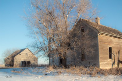 Abandoned farmhouse and shed in South Dakota. Enjoy and hold hands.