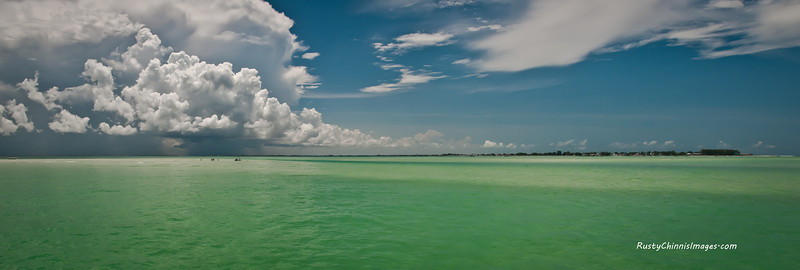 Anna Maria Island awaits a summer storm sweeping in from the mainland. This shot was taken on the shallows near the remains of Passage Key, once a thriving seabird nesting site.