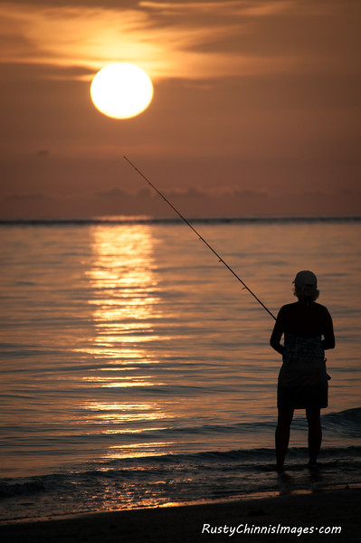 A west coast sunset looms as large as the expectation of a lucky angler