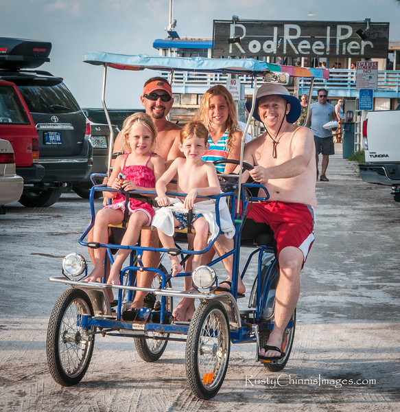 "A group of visitors from Michigan  enjoy the ""Old Florida"" ambiance of Anna Maria Island."
