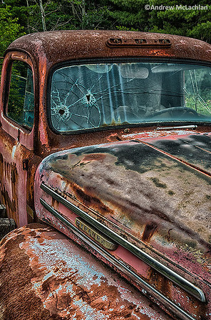 Dilapidated Mercury Pick-up Truck with Bullet Holes in the Windshield